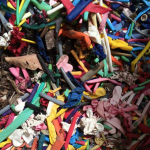colorful pile of broken latex balloons ready to be composted