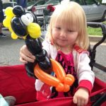 Young child adores balloon animals